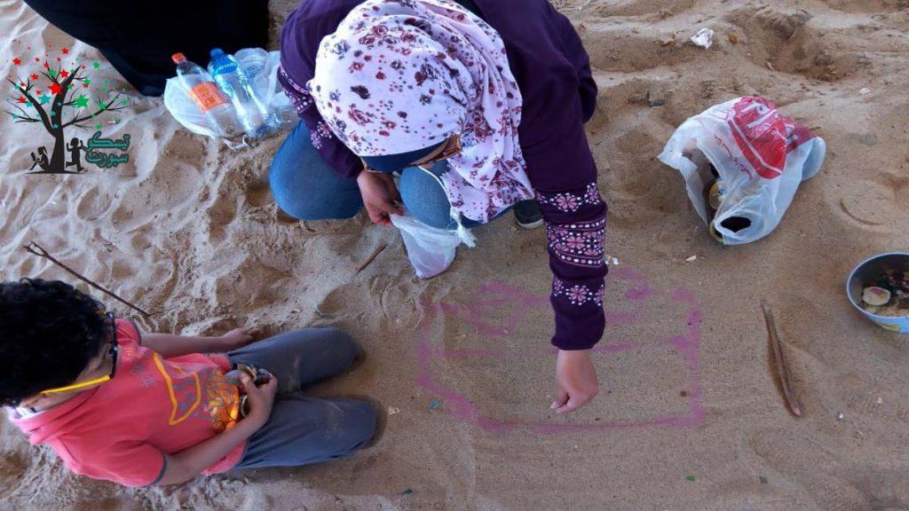 تعليم الفني الرسم على الرمال